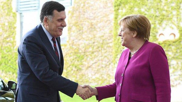 Файез аль-Саррадж и Ангела Меркель.