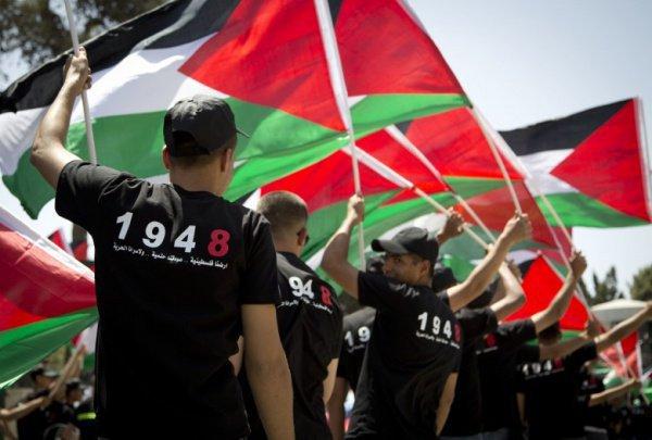 Палестинцы отмечают траурную дату.