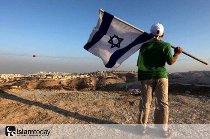 Две голубые полосы на государственном флаге современного Израиля означают реки Нил и Евфрат. (Источник фото: globalresearch.ca)