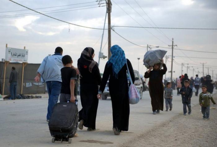 Беженцы продолжают возвращаться в Сирию.