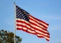 В США сатанисты пригрозили властям судом за упоминание Бога на флаге