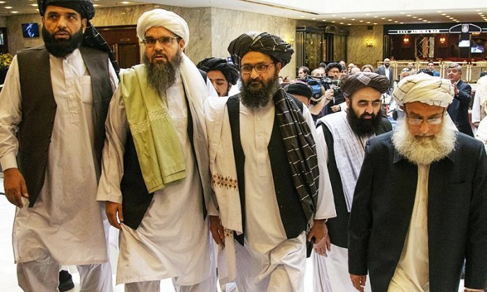 Делегация талибов на переговорах в Катаре.