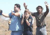 2 палестинца закрыли израильского полицейского от камней (ФОТО)