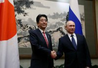 Премьер Японии надеется на встречу с Путиным на полях G20