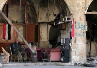 Амнистированные боевики восстанавливают Алеппо