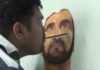 Художник нарисовал правителя Дубая, держа кисточку зубами (Видео)