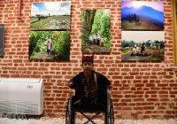 Мусульманин без рук и ног представил свои фото на международной выставке