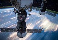 Космонавт снял спутник, пролетающий под МКС (ВИДЕО)