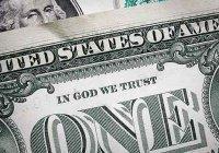 Атеисты потребовали убрать с долларов упоминание Бога