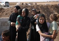 Более 1700 женщин и детей из России остаются в Сирии и Ираке